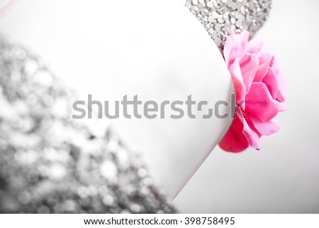 Delicious white wedding cake decorated flowers - stock photo