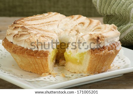 delicious whole home made lemon meringue pie - stock photo