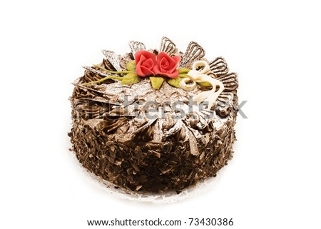 delicious whole homemade chocolate cake decorated with red roses - stock photo