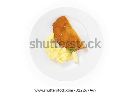 Delicious wiener schnitzel with mashed potatoes on plate on white background, top view. Traditional european cuisine. - stock photo