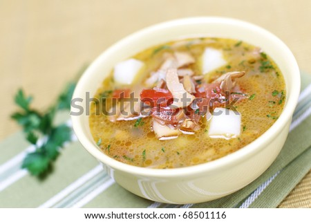 Delicious winter mushrooms soup with vegetables - stock photo