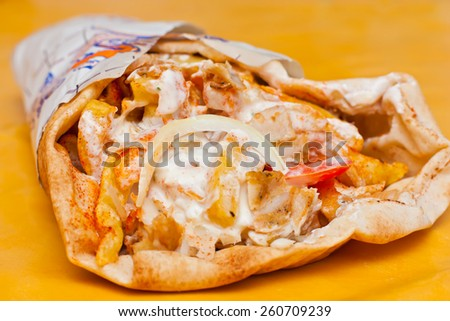 Delicious wrapped shawarma ready to eat. - stock photo