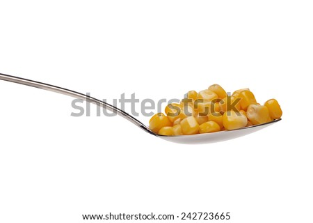 Delicious, yellow, canned corn in a silver spoon on a white background. - stock photo