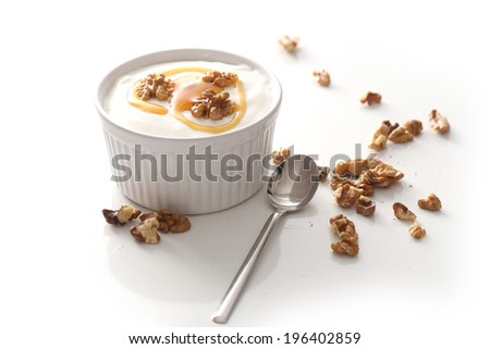 Delicious yoghurt with walnuts and honey - stock photo