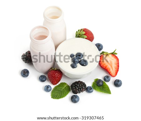 Delicious yogurts and fresh juicy berries isolated on white background