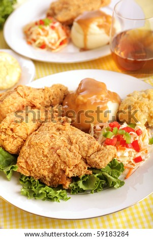 Deliciously golden brown fried chicken with all the tasty fixings - stock photo