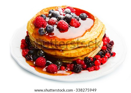 deliciuos pancake with fresh fruit on white - stock photo