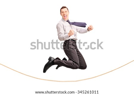 Delighted businessman jumping over a rope and gesturing joy isolated on white background - stock photo
