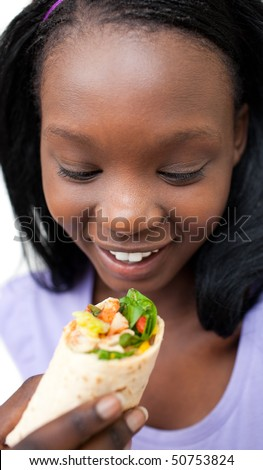 Delighted woman eating a wrap against a white background