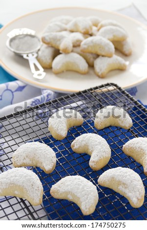 Delightful fresh baked Kourabiedes which is a Greek butter cookie with icing sugar. - stock photo