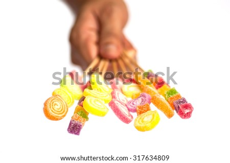Delivered jelly stick with blurred hand over white background - stock photo