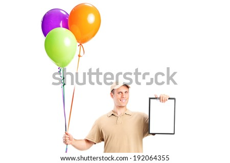 Delivery boy holding balloons and a clipboard isolated on white background - stock photo
