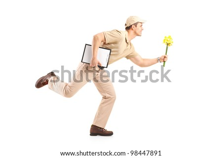 Delivery boy in a rush delivering flowers isolated on white background - stock photo