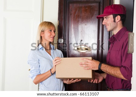 Delivery Boy with Box for Young Woman - stock photo