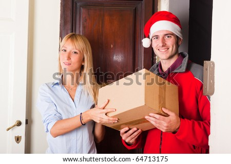 Delivery Boy with Christmas Hat and Box for Young Woman