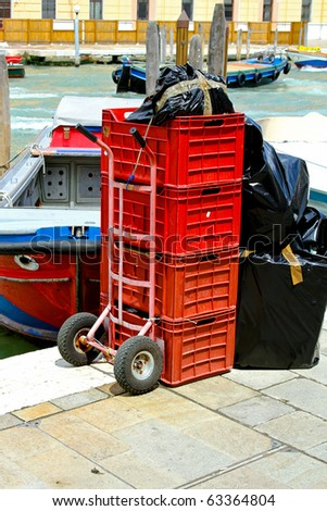 Delivery cart with red crates in Venice