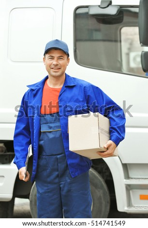 Delivery concept. Postman with parcel near a car