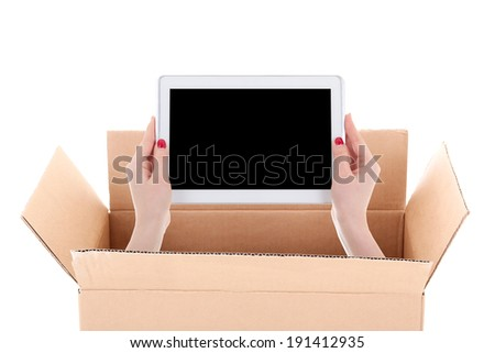 delivery concept - woman hands holding tablet pc with copyspace in cardboard box isolated on white background - stock photo