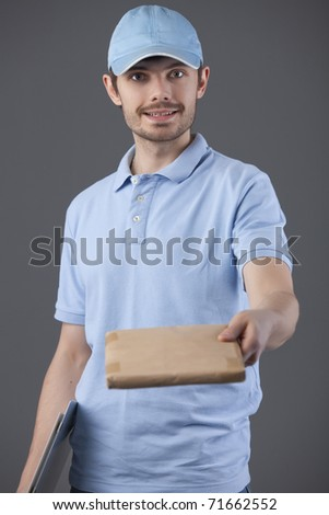 delivery courier with small package in his hand - stock photo