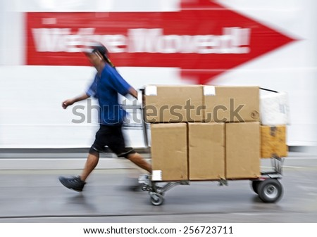 delivery goods with dolly by hand, purposely motion blur - stock photo