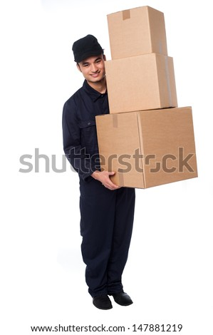 Delivery guy holding stack of parcel boxes - stock photo