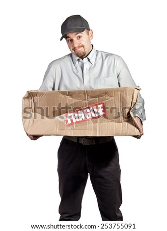delivery man and broken parcel - stock photo