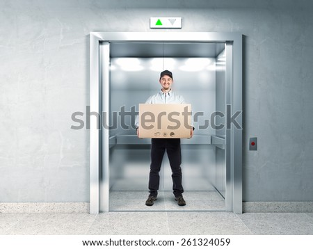 delivery man and elevator background - stock photo