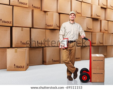 delivery man at work and 3d boxes background - stock photo