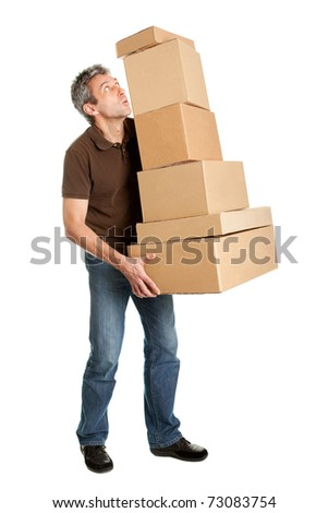 Delivery man balancing stack of boxes