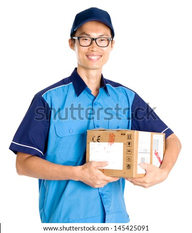 Delivery man carrying a parcel - stock photo
