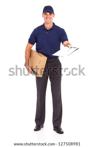 delivery man carrying a parcel and presenting receiving form for signing - stock photo
