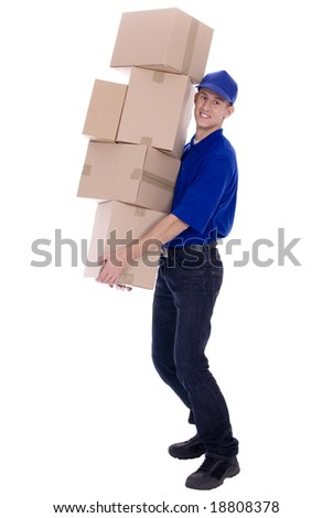 Delivery man carrying boxes - stock photo
