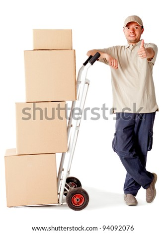 Delivery man carrying boxes with a trolley - isolated over a white background - stock photo