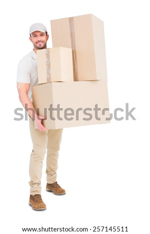Delivery man carrying cardboard boxes on white background - stock photo