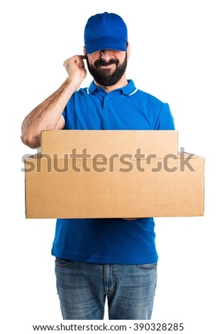 Delivery man covering his ears - stock photo