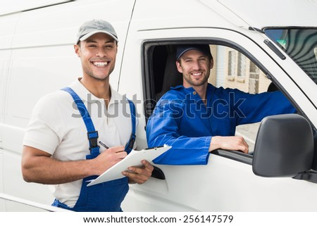 Delivery man getting signature from customer on white background - stock photo