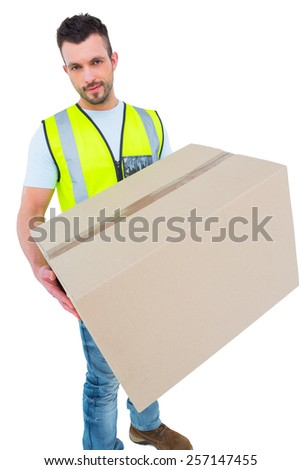 Delivery man holding cardboard box on white background - stock photo