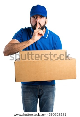 Delivery man making silence gesture - stock photo