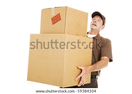Delivery man or mover about to drop a stack of large boxes.  Isolated on white. - stock photo