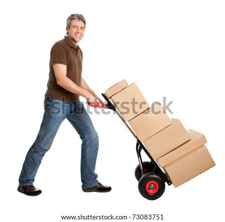 Delivery man pushing hand truck and stack of boxes - stock photo
