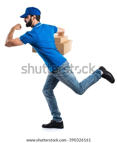 Delivery man running fast - stock photo