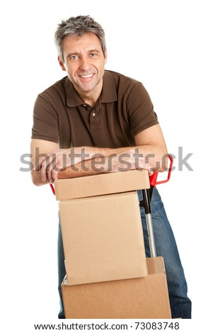 Delivery man with hand truck and stack of boxes - stock photo