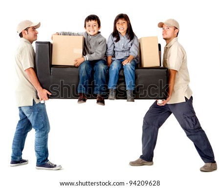 Delivery men carrying a heavy couch with kids - isolated over a white background - stock photo