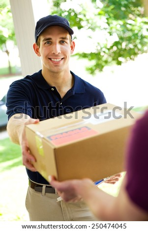 Delivery: Picking Up Package from Home - stock photo
