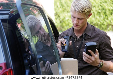 Delivery service man is scanning barcode - stock photo