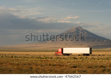 Delivery truck moving on Interstate 80 in Nevada, USA - stock photo