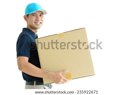 Deliveryman carrying a cardboard box - stock photo