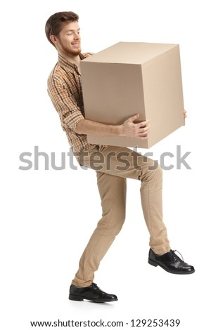 Deliveryman hardly carries the parcel, isolated, white background - stock photo
