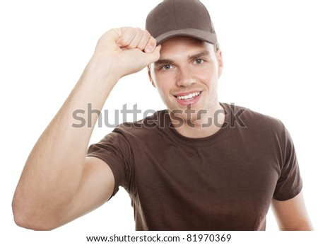 deliveryman tipping at his cap - stock photo