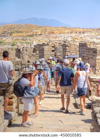 DELOS, GREECE - 18 june 2015 ;Tourists are visiting the famous archeologic site on the Island of Delos.Delos was one of the most sacred places of ancient Greece .Delos  is the birthplace of Apollo